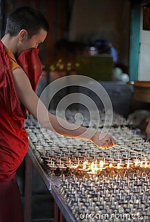 Mcleod Ganj, Dharamsala, India, Tibetan Buddhist monk Lighting Butterlamps Editorial Image