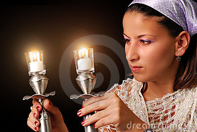 Lighting the candles for Jewish Sabbath
