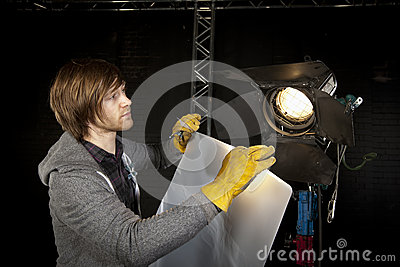 Lighting man in Television Studio