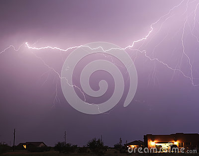 A Lightning Bolt Streaks Above a Neighborhood