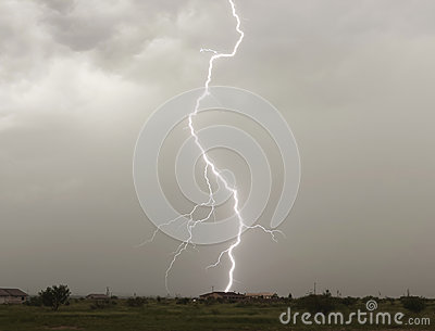 A Lightning Bolt Strikes a Rural Home