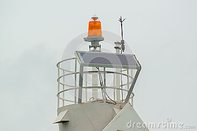 Lightning rod and solarcell on the top of lighthouse at the marina