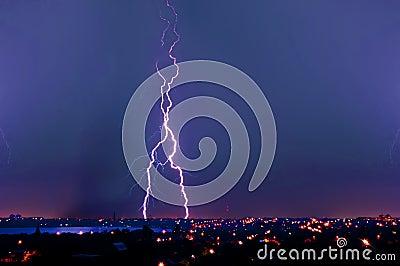 Lightning strike over dark blue sky