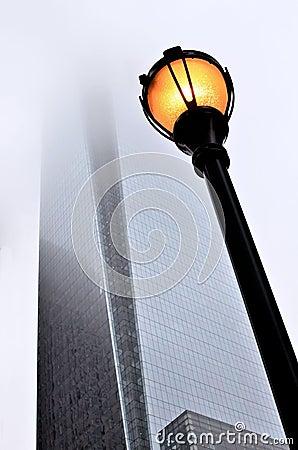 Lightpost and skyscraper
