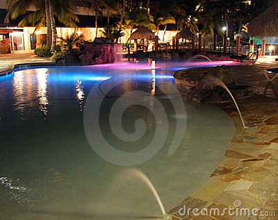 Lights reflected over a resort pool, Caribbean