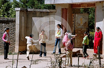 Lijiang Twp, China: Naxi Schoochildren at Play Editorial Image