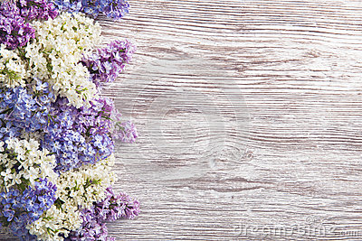 Lilac Flowers Bouquet on Wooden Plank Background, Spring Purple Stock Photo