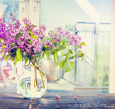 Free Lilac Flowers Bunch In Glass Vase On Window Still, Indoor. Royalty Free Stock Photo - 71764855