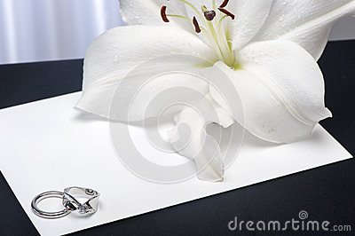A  Lilium and wedding rings