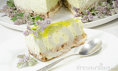 Lime cheesecake decorated with mint flowers