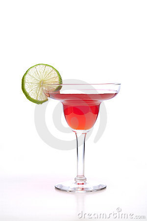 Lime garnish and red drink.