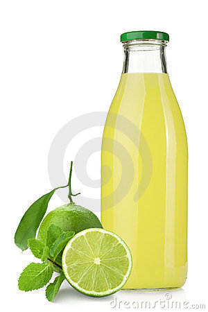 Lime juice bottle, ripe limes and mint