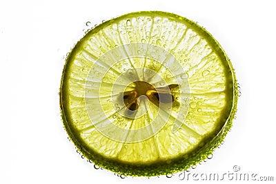 Lime slice floating in soda water