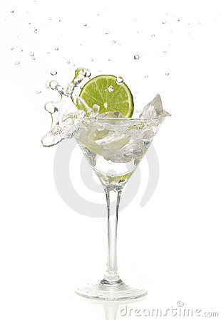 Lime splashing into a cocktail