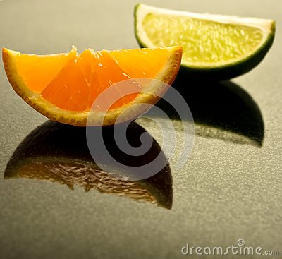 Lime and Tangerine wedges on polished granite
