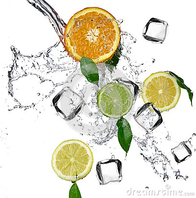 Limes and oranges with water splash and ice cubes