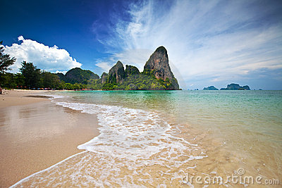limestone cliffs of Krabi bay overlooking a beach