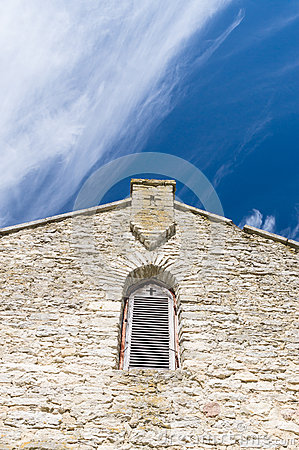 Free Limestone Facade Of Ancient Church With Window Shutter And Cross Stock Image - 55889311
