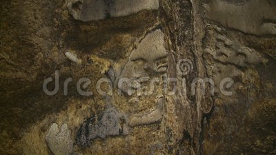 Limestone Walls Of Tempurung  Cave, KL, Malaysia. Close-up low-angle still shot of Gua Tempurung  Cave`s yellowish limestone wall with different rock structures stock footage