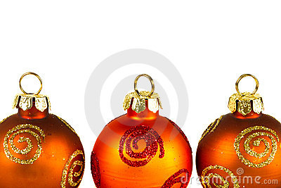 Line of Christmas baubles over white
