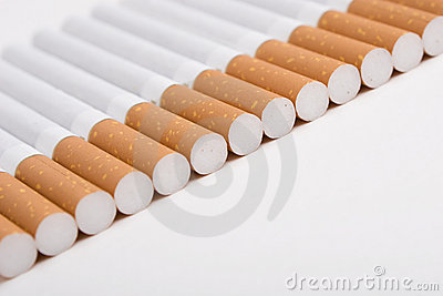 A line of cigarettes on the white