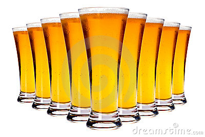 Line of glasses with lager beer