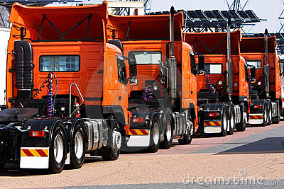 Line of heavy haulage orange trucks