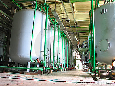 Line of industrial chemical tanks at power plant