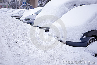 Line made of vehicles covered with snow