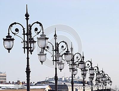 Line of many retro old-style city lanterns