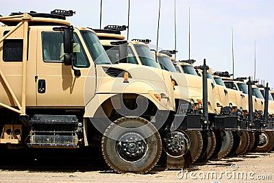Line of military transportation trucks