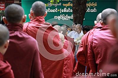 Line of monks, Myanmar Editorial Stock Image