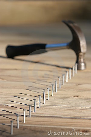 Line of nails and hammer