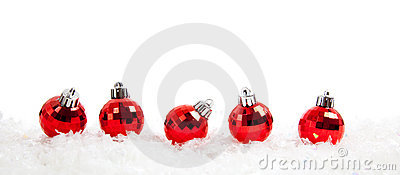 Line of Red christmas balls on snow
