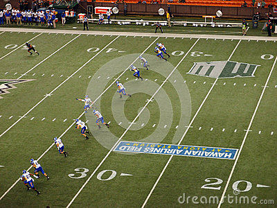 Line of SJSU players begin to run as they Kicks off the football Editorial Photo
