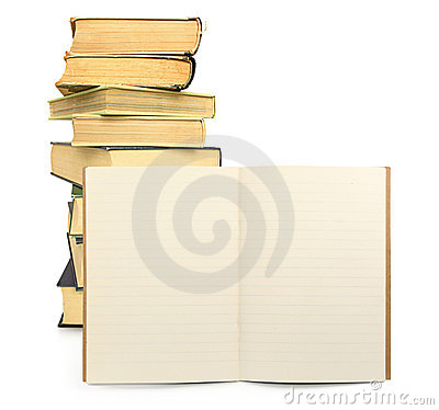 Lined exercise book with books in background