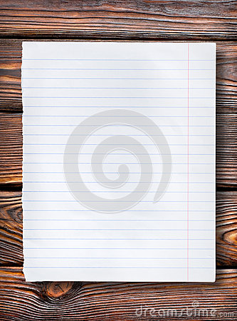 Lined paper on dark table