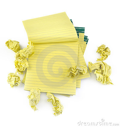 Lined paper notebooks and crumpled paper