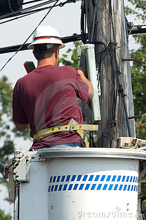 Lineman talking on a touchtone