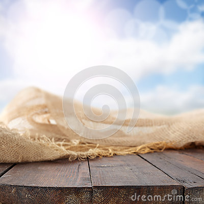 Linen cloth at rustic table with blue sky