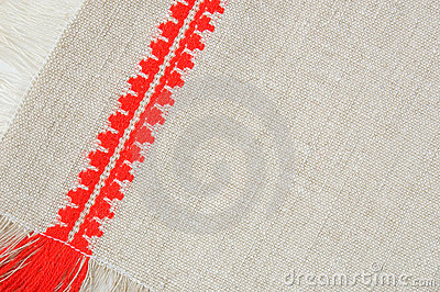 Linen pattern with red embroidery, close-up