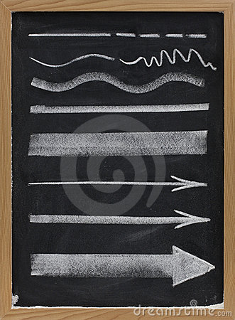 Lines and arrows - white chalk on blackboard