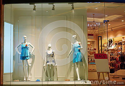 dress shop window with female mannequin Stock Photo