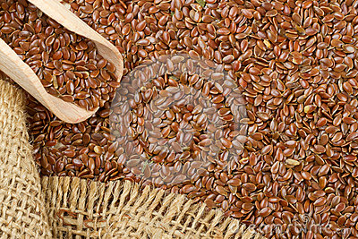 Linseed, flax seeds and wooden scoop