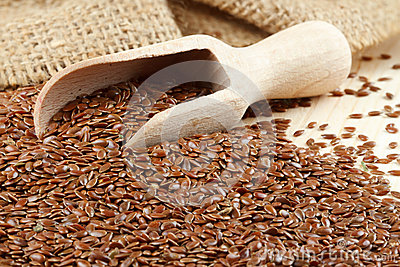 Linseed with wooden scoop