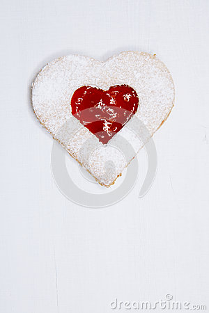 Linzer homemade cookie with heart shape raspberry jam window