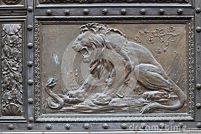 Lion on a metallic door Stock Photo