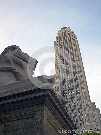 Lion Sculpture and Skyscraper