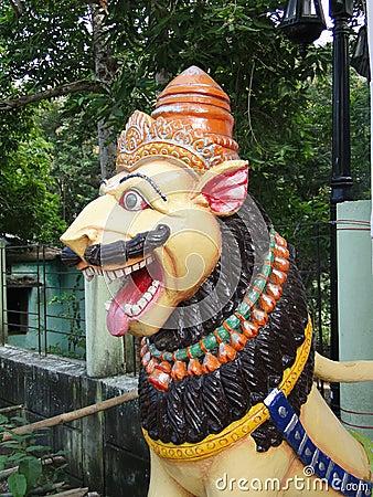 Lion statue guarding Shiva temple