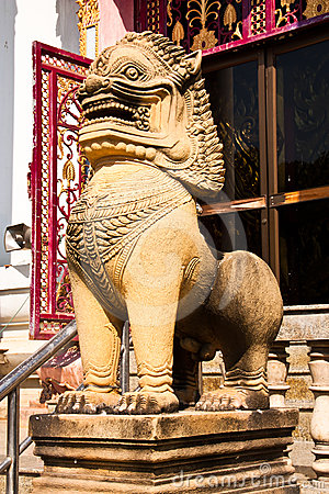 The lion statues made of stone.